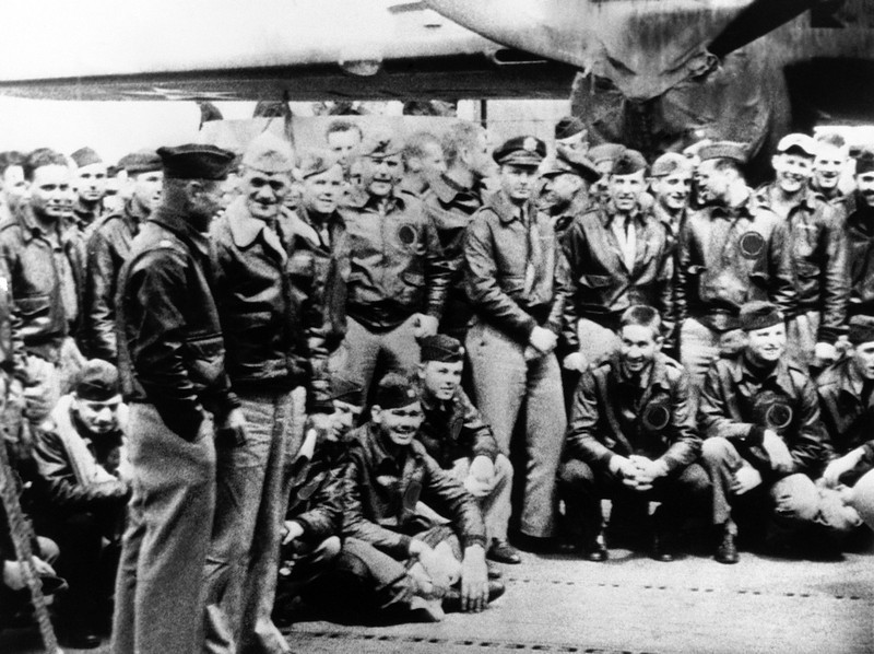 . In this undated file photo, orders in his hand, Capt. Marc A. Mitscher, skipper of the U.S.S. Hornet, discusses details for the take-off of Army members for the Tokyo raid with Maj. Gen. James H. Doolittle, foreground left. Survivors of the April 17, 1942 raid on Japan at the start of World War II celebrate the 70th anniversary of their raid on Japan April 17-20, 2012, in Dayton, Ohio. (AP File Photo)