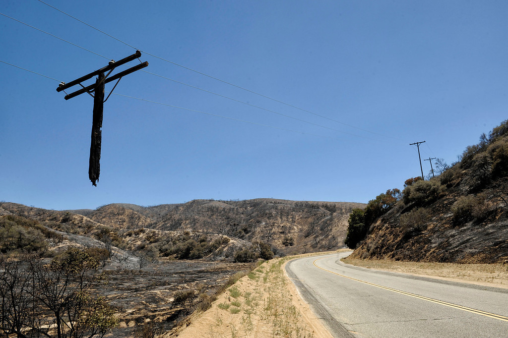 . power poles burned by the  Powerhouse fire along Munz Ranch Rd. (Hans Gutknecht/Los Angeles Daily News)