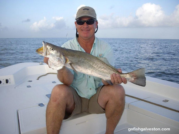 Capt. Tony Human with  7 lb 27 inch Speckled Trout