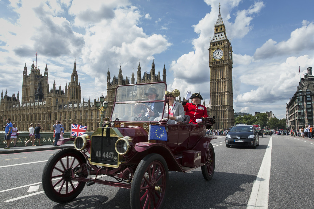 . LONDON, ENGLAND - AUGUST 4:   Chelsea Pensioners wave to members of the public as the Great War centenary parade of Edwardian cars crosses Westminster Bridge on August 4, 2014 in London, England.  Monday 4th August marks the 100th anniversary of Great Britain declaring war on Germany. In 1914 British Prime Minister Herbert Asquith announced at 11 pm that Britain was to enter the war after Germany had violated Belgium neutrality. The First World War or the Great War lasted until 11 November 1918 and is recognised as one of the deadliest historical conflicts with millions of causalities. A series of events commemorating the 100th anniversary are taking place throughout the day.  (Photo by Rob Stothard/Getty Images)