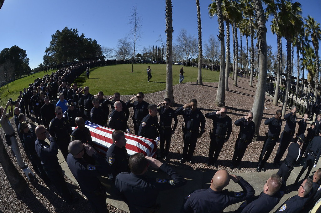. Thousands of people, including law enforcement officials from across the state, arrived at the Grove Community Church this morning to attend the funeral service for Riverside Police Officer Michael Crain. Numerous California law enforcement joined all 400 members of the Riverside Police Department during the procession for Crain, 34, who was killed Feb. 7 when a suspect believed to be Christopher Dorner ambushed him and his partner while on duty.  (Jeff Gritchen/Staff Photographer)