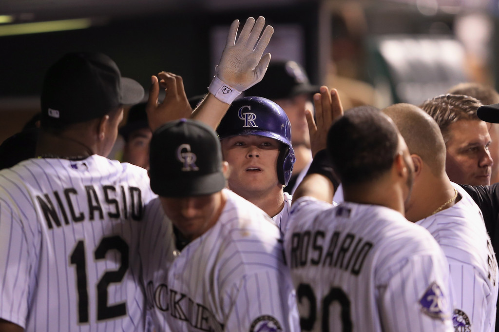 . Josh Rutledge #14 of the Colorado Rockies celebrates his pinch hit solo home run off of Paco Rodriguez #75 of the Los Angeles Dodgers in the eighth inning at Coors Field on September 3, 2013 in Denver, Colorado.  (Photo by Doug Pensinger/Getty Images)