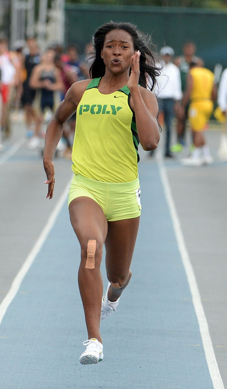 . Long Beach Poly\'s Arianna Washington wins the division 1 100 meter dash during the CIF Southern Section track and final Championships at Cerritos College in Norwalk, Calif., Saturday, May 24, 2014.   (Keith Birmingham/Pasadena Star-News)