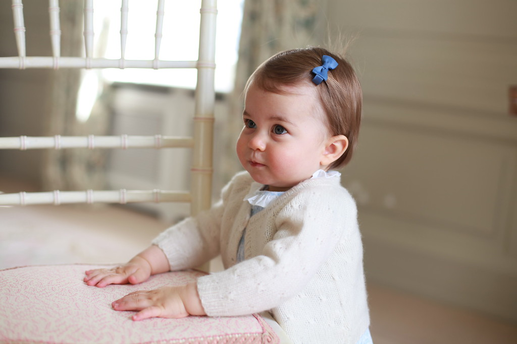 . In this undated photo provided by HRH The Duke and Duchess of Cambridge released on May 1, 2016, Princess Charlotte of Cambridge looks up with her hands placed on a chair as her mother Catherine, Duchess of Cambridge takes her photo ahead of her first birthday on May 2, 2016 at Anmer Hall on April 2016 in Norfolk, England. The young Princess will celebrate her first birthday on May 2. (Photo by HRH The Duchess of Cambridge via Getty mages)