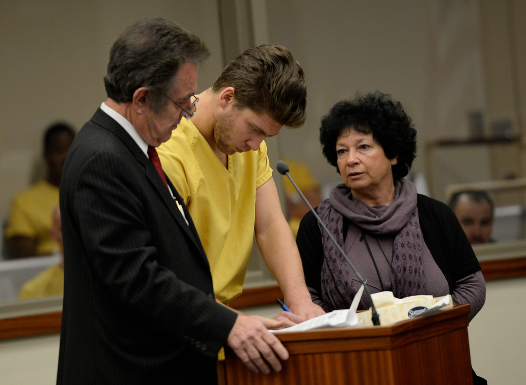 . Semyon Varlamov, starting goaltender for the Colorado Avalanche, between his attorney Jack Rotole, left, and a russian interpreter, appears in court in Denver on kidnapping and assault charges related to the case, which the woman said happened Monday at their apartment, October 31, 2013. The judge set his bond at $5,000. (Photo By RJ Sangosti/The Denver Post)
