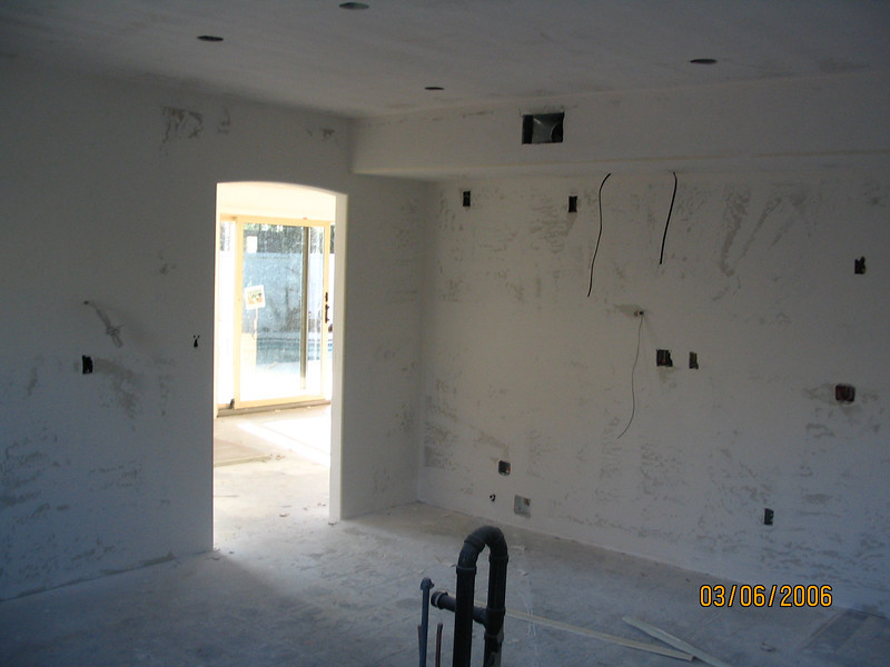 Kitchen - drywalled and textured.
