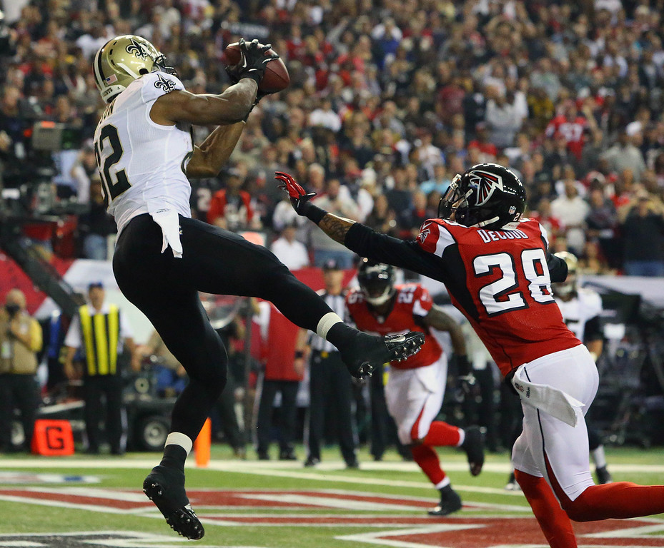 . Saints tight end Benjamin Watson catches a touchdown pass as Falcons safety Thomas DeCoud defends during the first half of an NFL football game, Thursday, Nov. 21, 2013 in Atlanta. (AP Photo/Atlanta Journal-Constitution, Curtis Compton)