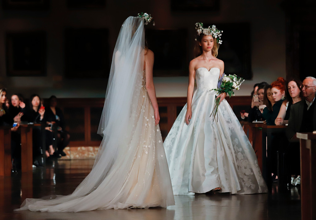 . Bridal fashion from the Reem Acra collection is modeled during Bridal Fashion Week, Thursday April 12, 2018 in New York. (AP Photo/Bebeto Matthews)