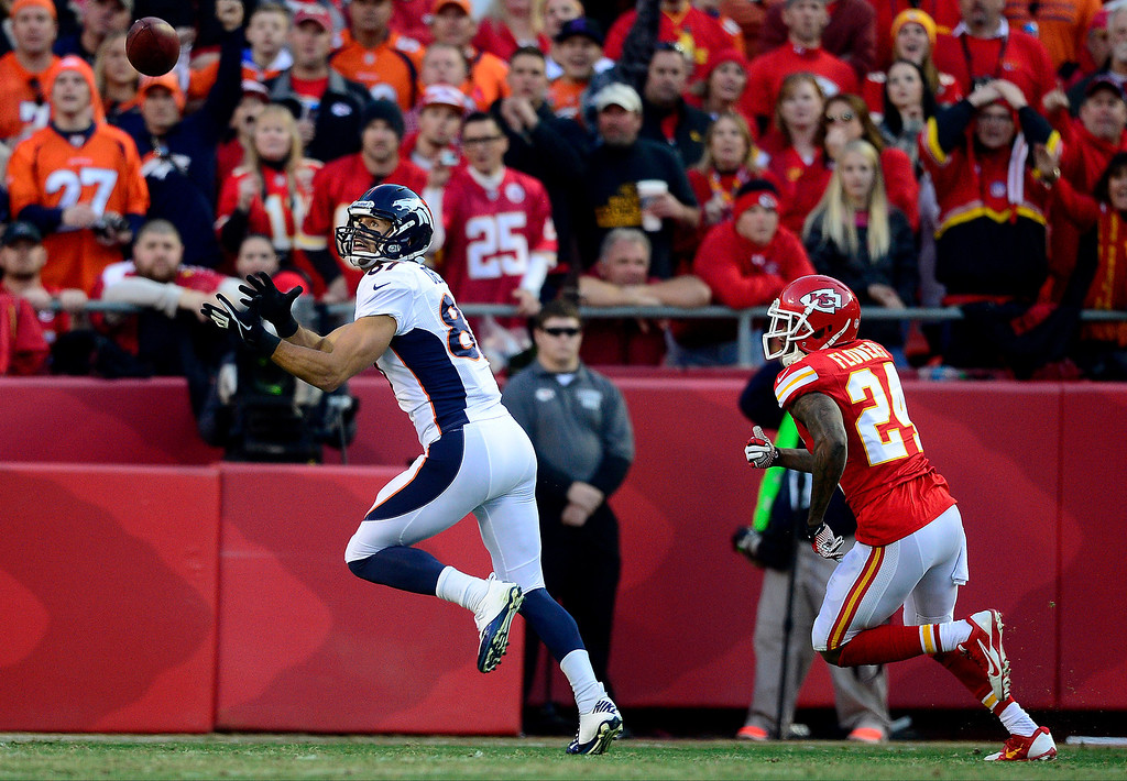 . Eric Decker (87) of the Denver Broncos makes his first touchdown catch of the day as Brandon Flowers (24) of the Kansas City Chiefs covers during the first half of action at Arrowhead Stadium.  (Photo by AAron Ontiveroz/The Denver Post)
