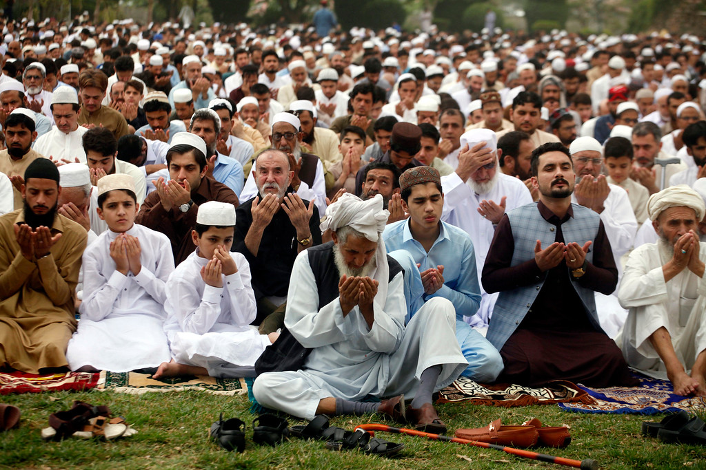 . Pakistani faithful offer Eid al-Fitr prayers to celebrating the end of the holy month of Ramadan in Peshawar, Pakistan, Friday, June 15, 2018. Eid al-Fitr is being celebrated in parts of Khyber-Pakhtunkhwa province on Friday while rest of Pakistan will begin the festivities on Saturday. (AP Photo/Muhammad Sajjad)