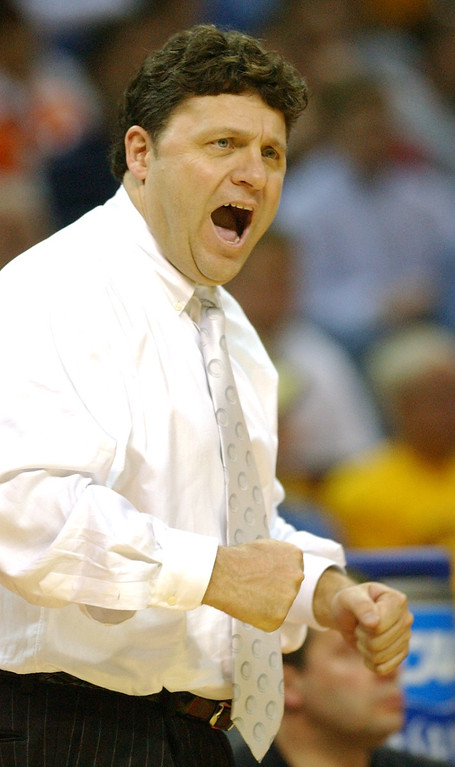 . Oakland University men\'s basketball head coach Greg Kampe yells instructions to his team as they played North Carolina during first half action, Friday, March 18, 2005, at the Charlotte Coliseum in Charlotte, NC.  Oakland lost to North Carolina, 96-68.