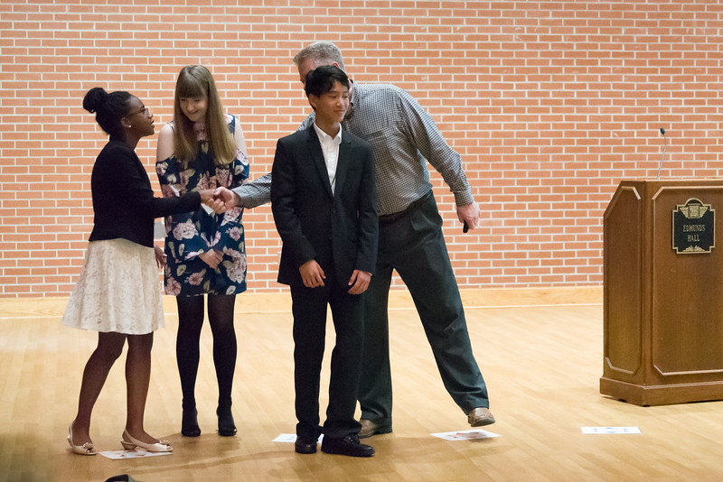 Chi-Chi Nwanagu shakes Dr. Kaup's hand for Microbiology non-mentored.