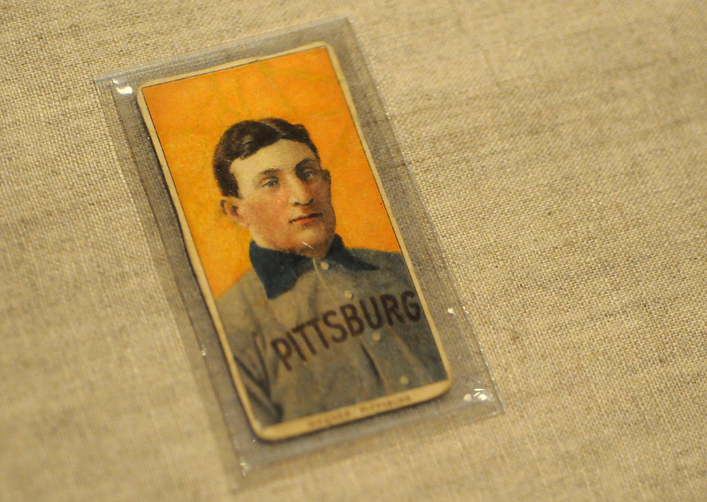 ". One of the most prized treasures in baseball is this Honus Wagner baseball card, included in the ""Baseball!\"" exhibit.The Exhibition opens April 4, 2014 at the Ronald Reagan Presidential Library and Museum.  Running through September 4, 2014, Baseball is a 12,000 square foot exhibition featuring over 700 artifacts, including some of the rarest, historic and iconic baseball memorabilia.  (Photo by Dean Musgrove/Staff Photographer)"