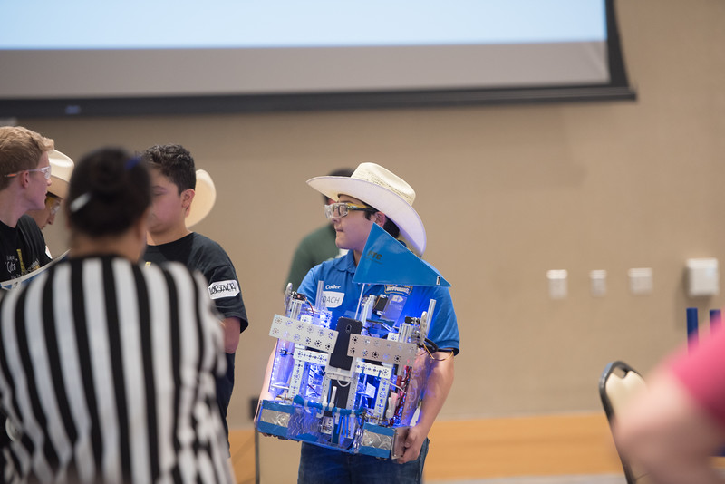 Amado Lazo carries his team's robot to the arena. Saturday January 21, 2017 during the First Tech Challenge at TAMU-CC.