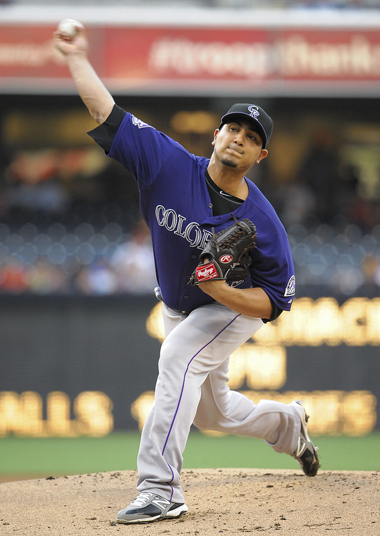 . Jhoulys Chacin #45 of the Colorado Rockies pitches during the first inning of a baseball game against the San Diego Padres at Petco Park on July 9, 2013 in San Diego, California.  (Photo by Denis Poroy/Getty Images)