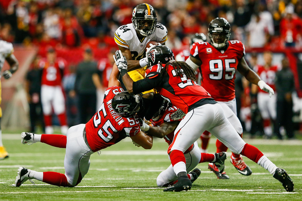 . ATLANTA, GA - DECEMBER 14: Antonio Brown #84 of the Pittsburgh Steelers is tackled by Paul Worrilow #55, Kemal Ishmael #36 and Dezmen Southward #41 of the Atlanta Falcons after a reception in the first half at the Georgia Dome on December 14, 2014 in Atlanta, Georgia.  (Photo by Kevin C. Cox/Getty Images)