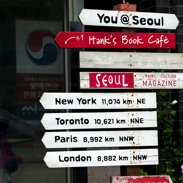 Sign showing distance to various cities of the world from Seoul, South Korea