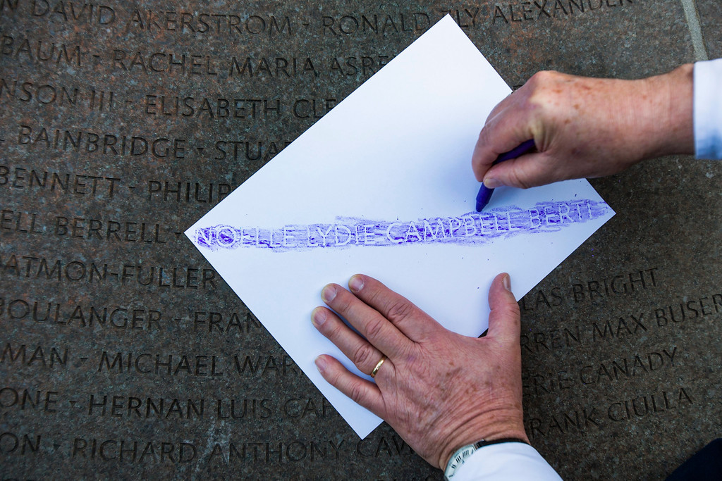. Richard Johns makes an etching of his friend\'s name, Noelle Lydie Campbell Berti, from a memorial cairn in Arlington National Cemetery which honors those killed on Pan Am flight 103 on the 25th anniversary of the incident in Arlington, Virginia, USA, 21 December 2013. Libyan terrorists blew up the plane over Lockerbie, Scotland; the terrorist act killed 243 passengers and 16 crew members, as well as 11 people on the ground.  EPA/JIM LO SCALZO