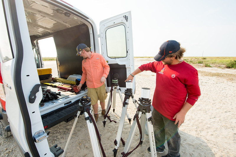 Brian Lorentson and Alistair Lord set up one of several instruments used during the survey of the Mustang Island area  The Conrad Blucher Institute  collects data following Hurricane Harvey's impact in the coastal bend.