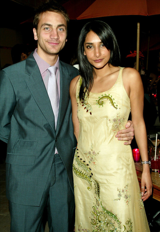 """. CANNES, FRANCE - MAY 15:    Singer Rebecca Hazlewood and Luke Walker attend the \""""Bollywood\"""" party at the Savoy Hotel during the 56th International Cannes Film Festival on May 15, 2003 in Cannes, France. (Photo by Evan Agostini/Getty Images)"""