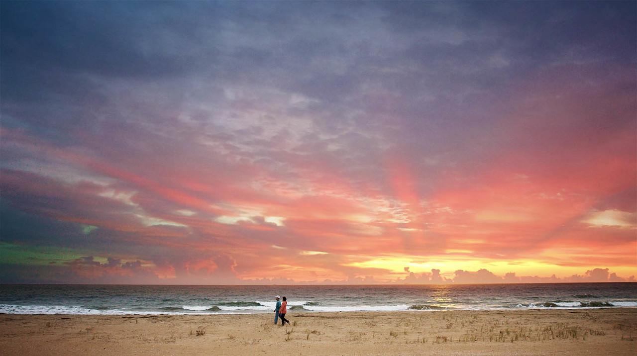 Enjoy a vivid sunset on a fall trip to Virginia Beach.