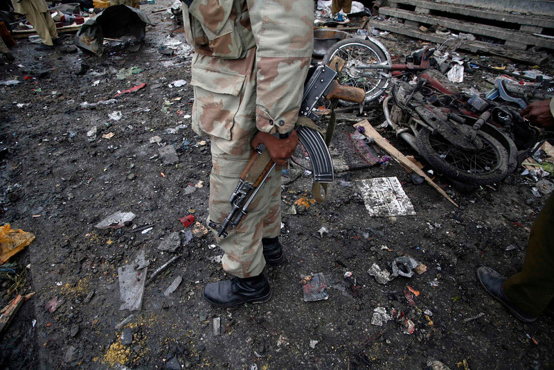 . A paramilitary soldier stands the scene of a bomb explosion in Quetta January 10, 2013. At least 12 people, including a child and two security personnel, were killed and 30 others injured in a blast that took place near Quetta\'s Bacha Khan chowk on Thursday, local media said. REUTERS/Naseer Ahmed