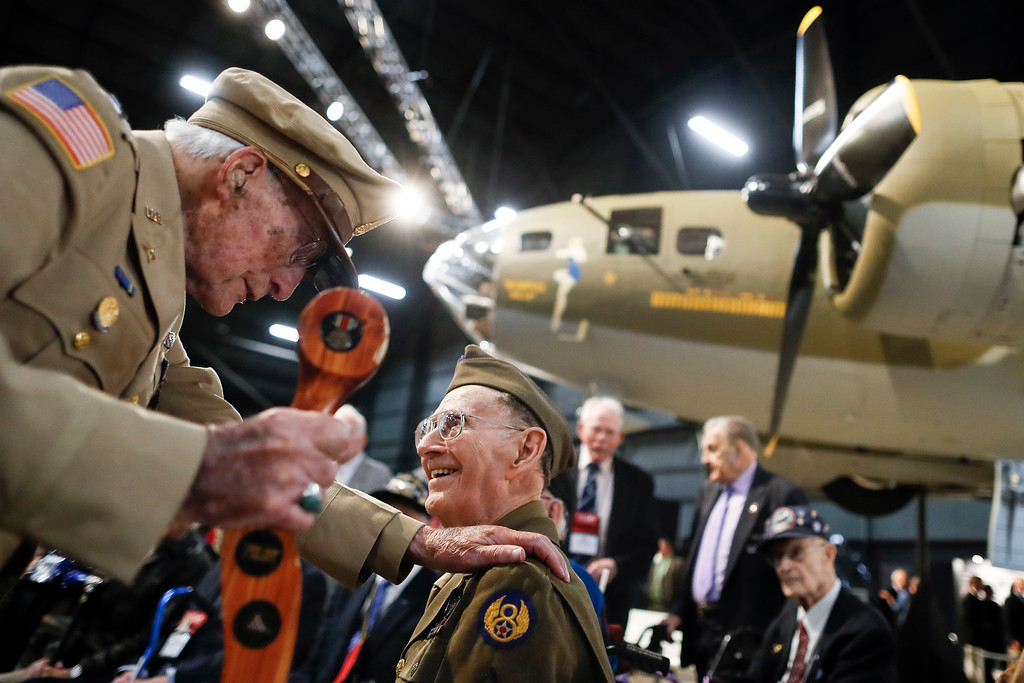 ". Veterans gather for a private viewing of the Memphis Belle, a Boeing B-17 ""Flying Fortress,\"" at the National Museum of the U.S. Air Force, Wednesday, May 16, 2018, in Dayton, Ohio. The World War II bomber Memphis Belle is set to go on display for the first time since getting a yearslong restoration at the museum. The B-17 �Flying Fortress� will be introduced Thursday morning as the anchor of an extensive exhibit in the Dayton-area museum�s World War II gallery.  (AP Photo/John Minchillo)"