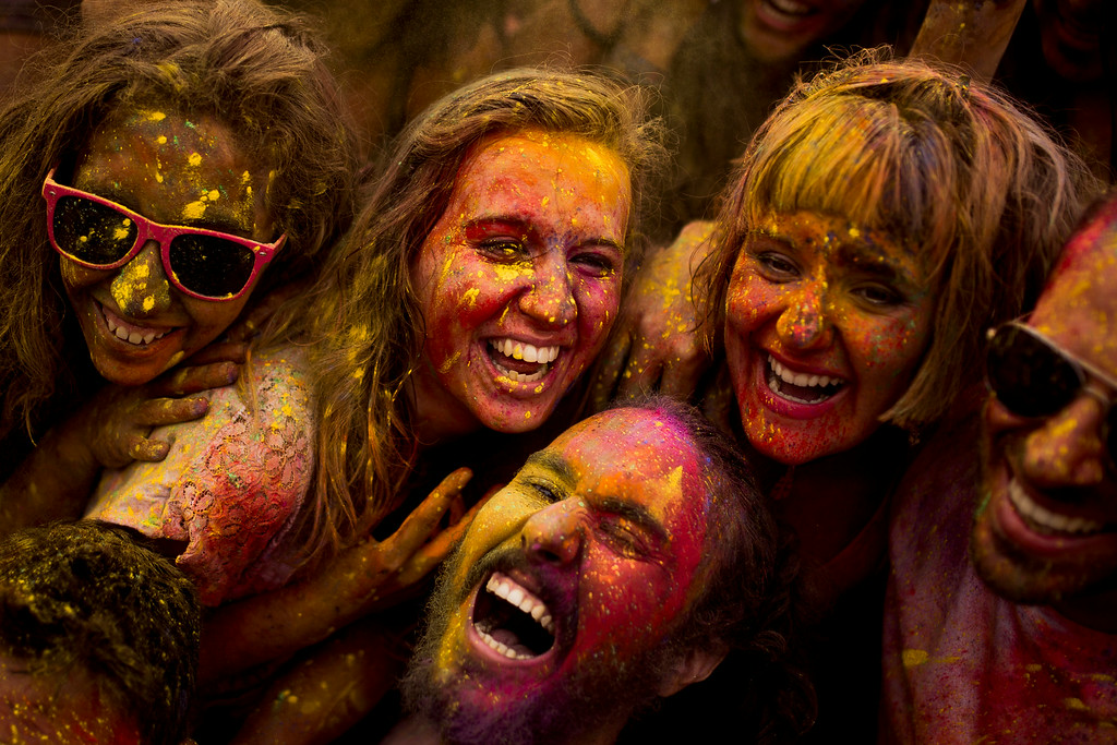 . Revelers pose for a self portrait after throwing special colored powders in the air during a Monsoon Holi Festival in Madrid, Spain, Saturday, Aug. 9, 2014. The festival is based on the Hindu spring festival Holi, also known as the festival of colors where participants color each other with dry powder and colored water.   (AP Photo/Andres Kudacki)