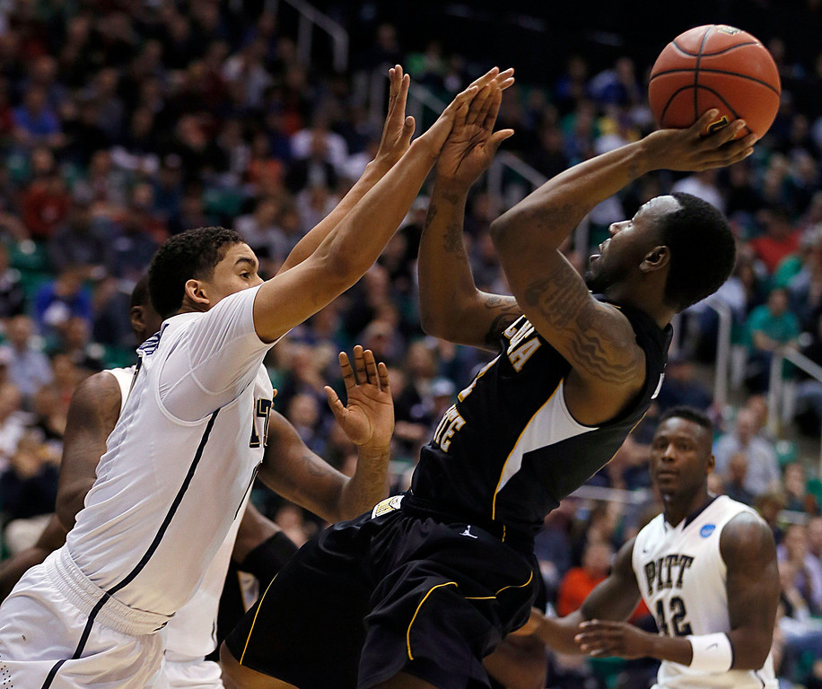. Wichita State\'s Malcolm Armstead, right, shoots over Pittsburgh\'s James Robinson in the second half during a second-round game in the NCAA college basketball tournament in Salt Lake City, Thursday, March 21, 2013. (AP Photo/George Frey)