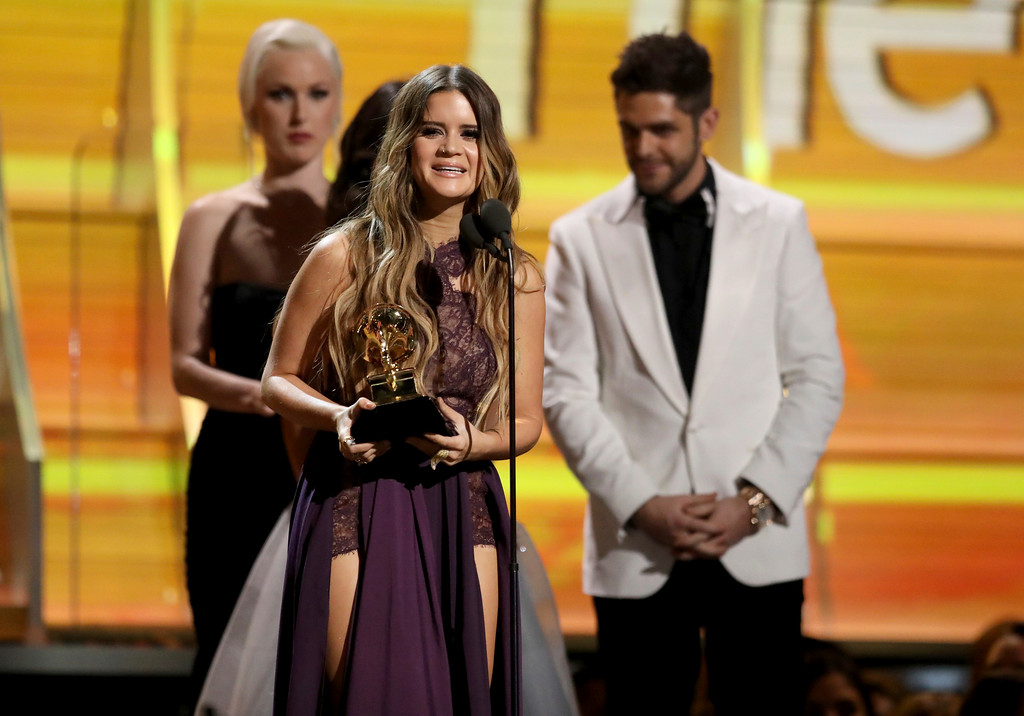". Maren Morris accepts the award for best country solo performance for ""My Church\"" at the 59th annual Grammy Awards on Sunday, Feb. 12, 2017, in Los Angeles. (Photo by Matt Sayles/Invision/AP)"