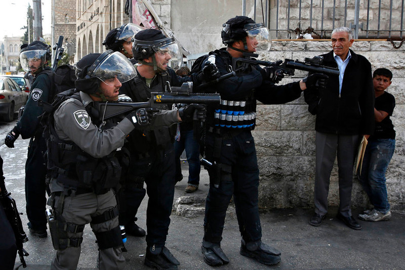 . Israeli security forces stand in position as they clash with Palestinian protestors during a demonstration for Nakba (Catastrophe) day near Damascus Gate at Jerusalem\'s old city May 15, 2013. Palestinians clashed with Israeli forces in the occupied West Bank and at East Jerusalem on Wednesday during demonstrations to mark 65 years since what they call the Nakba (Catastrophe) when Israel\'s creation caused many to lose their homes and become refugees. REUTERS/Baz Ratner