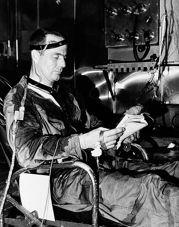 . To measure the ability of Project Mercury astronaut candidates to function under the stress of heat, they were put into a heat chamber for an extended period. With the temperature at 130 degrees Fahrenheit, Scott S. Carpenter spends this period reading. Test was conducted at Wright Air Development Center, Ohio, April 8, 1959. (AP Photo)