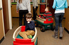Keegan and Sam take a wagon ride through the halls of the school during the CARE worship program at St Michael the Archangel. Photo by Susan McSpadden 011313