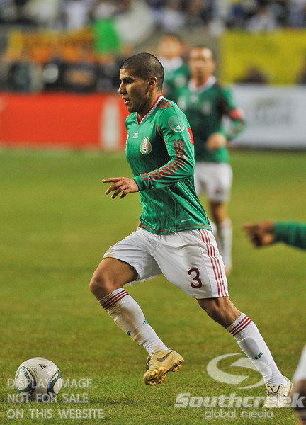 Mexico's Defender Carlos Salcido (#3) moves toward the goal in Soccer action between Bosnia-Herzegovina and Mexico.  Mexico defeated Bosnia-Herzegovina 2-0 in the game at the Georgia Dome in Atlanta, GA.