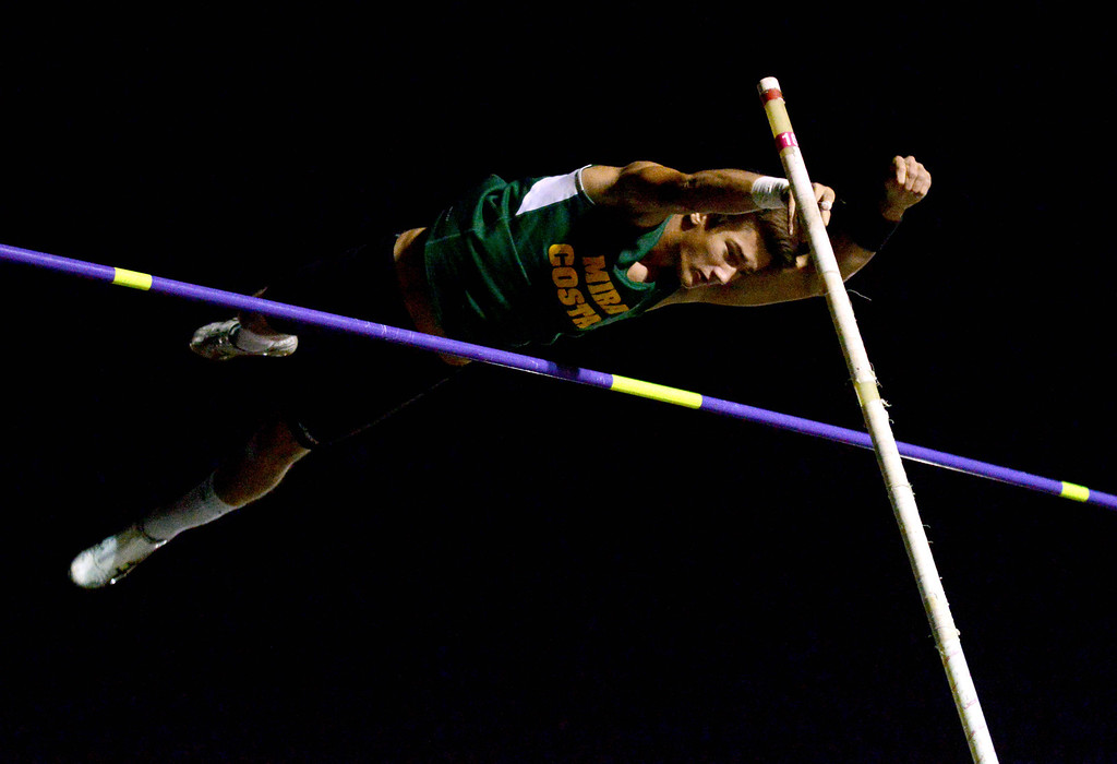 . 05-03-2013-(LANG Staff Photo by Sean Hiller)-  Mira Costa\'s Reed Scale competing in the pole vault in the Bay League track and field finals Friday night at Mira Costa High School.