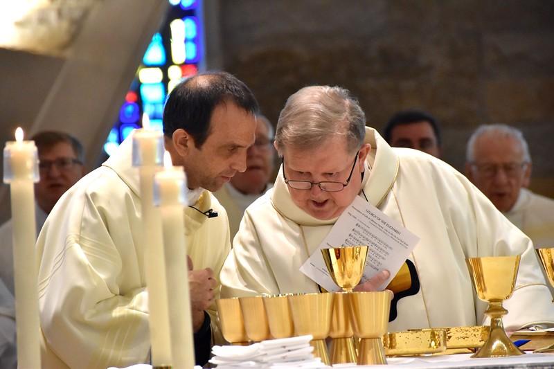 Last minute details during Eucharist