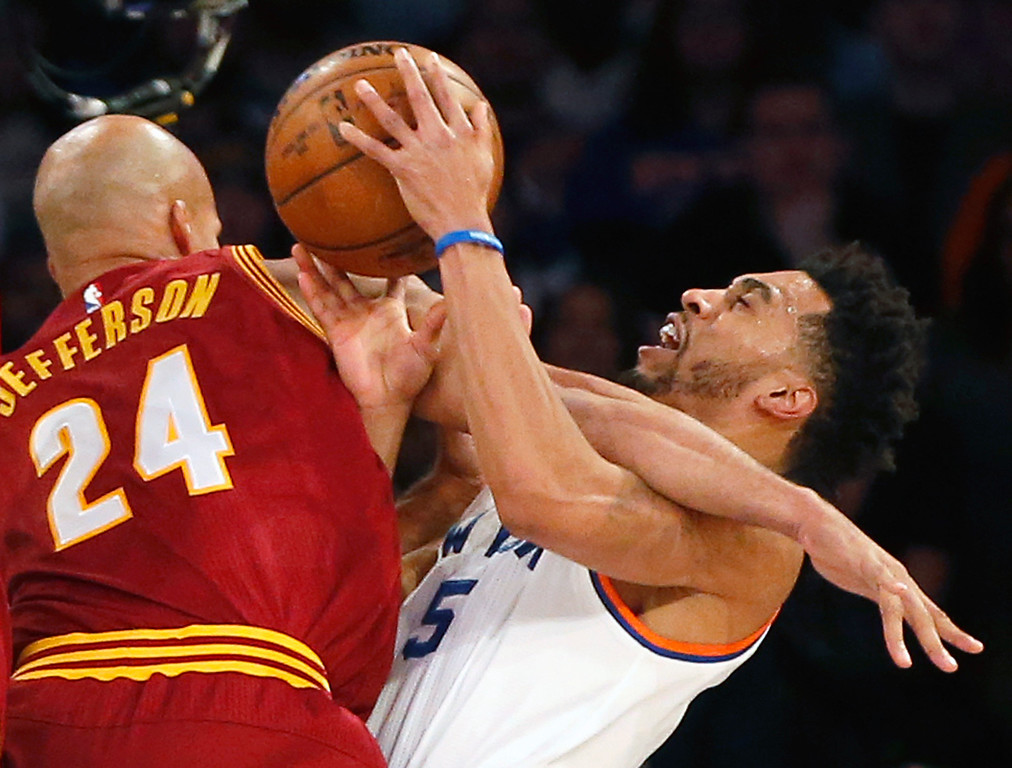 . Cleveland Cavaliers forward Richard Jefferson (24) gets tangled up with New York Knicks guard Courtney Lee (5) in the first quarter of an NBA basketball game at Madison Square Garden in New York, Wednesday, Dec. 7, 2016. (AP Photo/Kathy Willens)