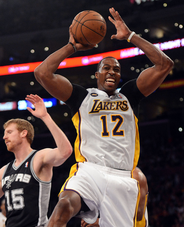 . The Lakers\'  Dwight Howard #12 reacts during game four of their NBA Western Conference playoffs against the Spurs at the Staples Center Saturday, April 28, 2013. The Spurs beat the Lakers 120-89. The Spurs beat the Lakers 103-82. (Hans Gutknecht/Staff Photographer)