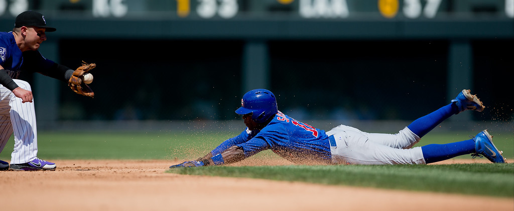 . Alfonso Soriano #12 of the Chicago Cubs slides in late to the bag as Troy Tulowitzki #2 of the Colorado Rockies prepares to apply the tag for an out during the fourth inning at Coors Field on July 21, 2013 in Denver, Colorado. The Rockies defeated the Cubs 4-3.  (Photo by Justin Edmonds/Getty Images)