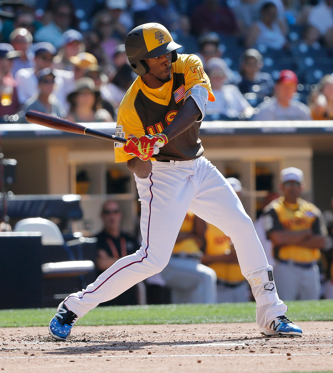 . U.S. Team\'s Travis Demeritte, of the Texas Rangers, hits against the World Team during the second inning of the All-Star Futures baseball game, Sunday, July 10, 2016, in San Diego. (AP Photo/Lenny Ignelzi)