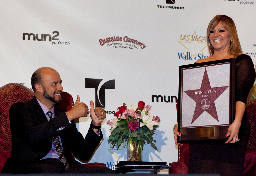 Description of . In this July 1, 2011 file photo, singer Jenni Rivera, right, poses with a replica of a star for the Las Vegas Walk of Stars as her husband, former Major League Baseball pitcher Esteban Loaiza, reacts during an official presentation ceremony in Las Vegas. The wreckage of a small plane believed to be carrying Mexican-American music superstar Jenni Rivera was found in northern Mexico on Sunday, Dec. 9, 2012, and there are no apparent survivors, authorities said. (AP Photo/Julie Jacobson, File)