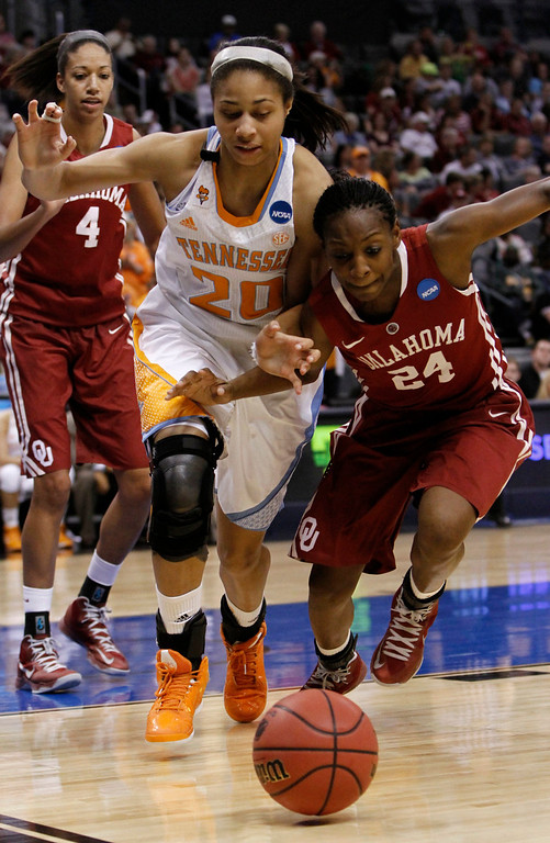 . Tennessee\'s center Isabelle Harrison (20) and Oklahoma\'s guard Sharane Campbell (24) go after a loose ball in the second half of their game during the regional semifinal in the women\'s NCAA college basketball tournament in Oklahoma City Sunday March 31, 2013.  Tennessee won 74-59.   (AP Photo/Alonzo Adams)