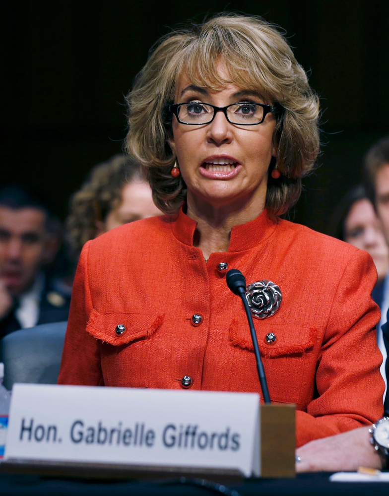 Description of . Former U.S. Rep. Gabrielle Giffords delivers her statement during a hearing held by the Senate Judiciary committee about guns and violence on Capitol Hill in Washington, January 30, 2013.   REUTERS/Larry Downing