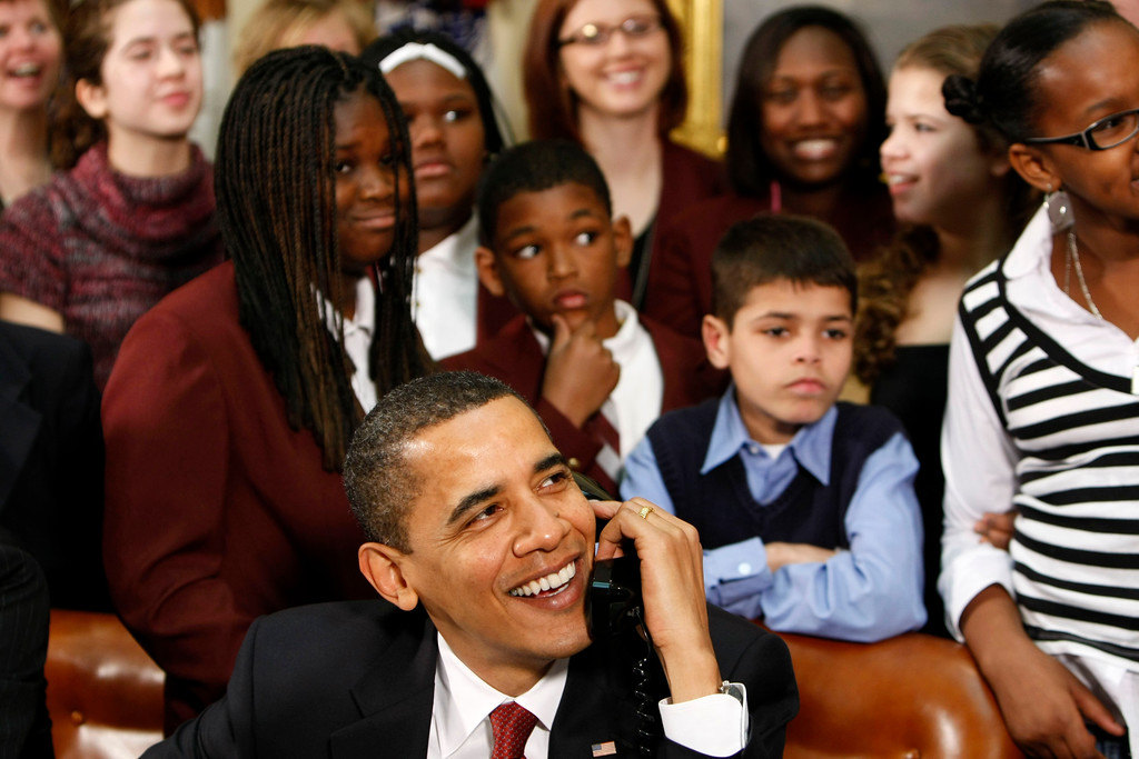 . President Barack Obama, accompanied by members of Congress and school children, talks to astronauts on the International Space Station, Tuesday, March 24, 2009, from the Roosevelt Room of the White House in Washington. (AP Photo/Gerald Herbert)