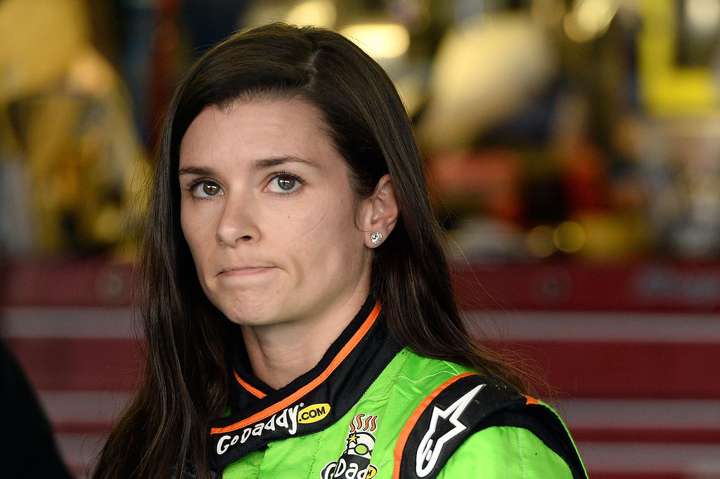 . TALLADEGA, AL - MAY 04:  Danica Patrick, driver of the #34 AccuDoc Solutions / GoDaddy Chevrolet, looks on in the garage after she suffered damage to her car and was knocked out of the race during the NASCAR Nationwide Series Aaron\'s 312 at Talladega Superspeedway on May 4, 2013 in Talladega, Alabama.  (Photo by Patrick Smith/Getty Images)