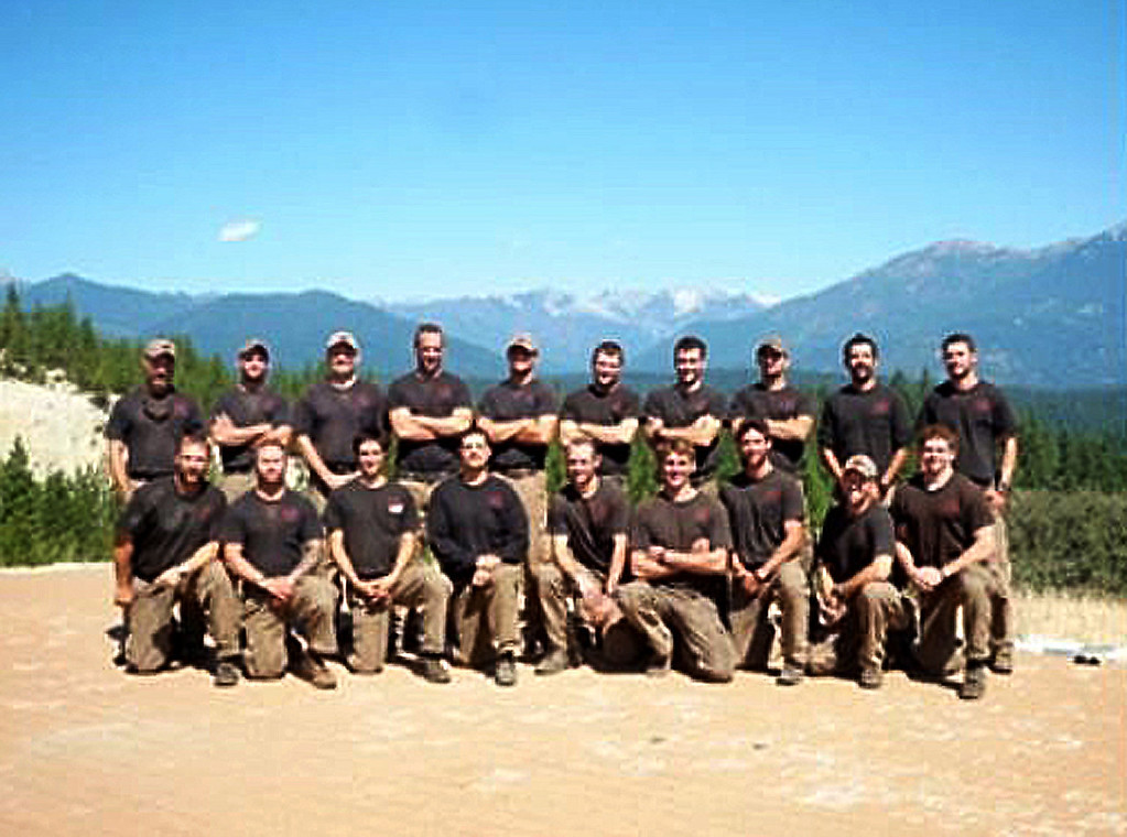 """. This undated picture provided by KPHO-TV/CBS-5-AZ.COM shows the Prescott Granite Mountain Hotshot crew of Prescott, Arizona. 19 hotshot firefighters were killed Sunday battling a fast-moving wildfire in Arizona, in one of the worst incidents of its kind in US history, as flames ravaged homes and forced the evacuation of two towns. The firefighters died while racing to contain the Yarnell Hill wildfire about 85 miles (135 kilometers) north of Phoenix, in what Arizona governor Jan Brewer called \""""as dark a day as I can remember.\""""   (KPHO-TV/CBS-5-AZ.COM/AFP/Getty Images)"""