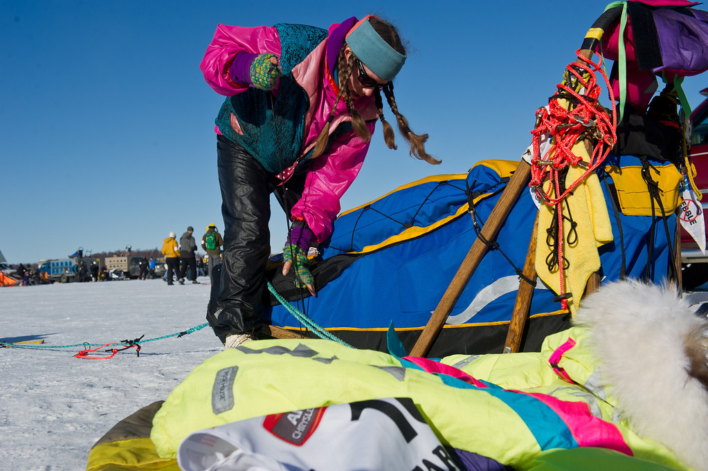 . Musher Monica Zappa prepares her sled before the start of the Iditarod Trail Sled Dog Race on Willow Lake, Sunday, March 2, 2014, in Willow, Alaska. The race will take mushers nearly a thousand miles to the finish line in Nome, on Alaska\'s western coast. (AP Photo/Anchorage Daily News, Marc Lester)