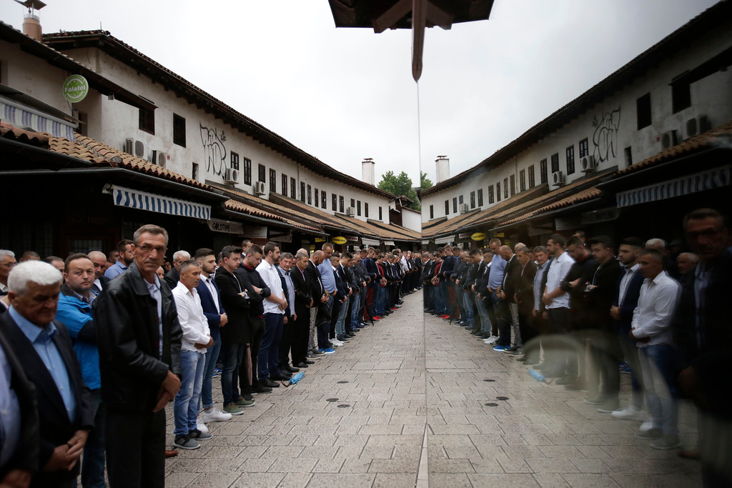 . Bosnian Muslims offer prayers during the first day of Eid al-Fitr, which marks the end of the holy fasting month of Ramadan on a street near Begova Mosque in Sarajevo, Bosnia early Friday, June 15, 2018. (AP Photo/Amel Emric)