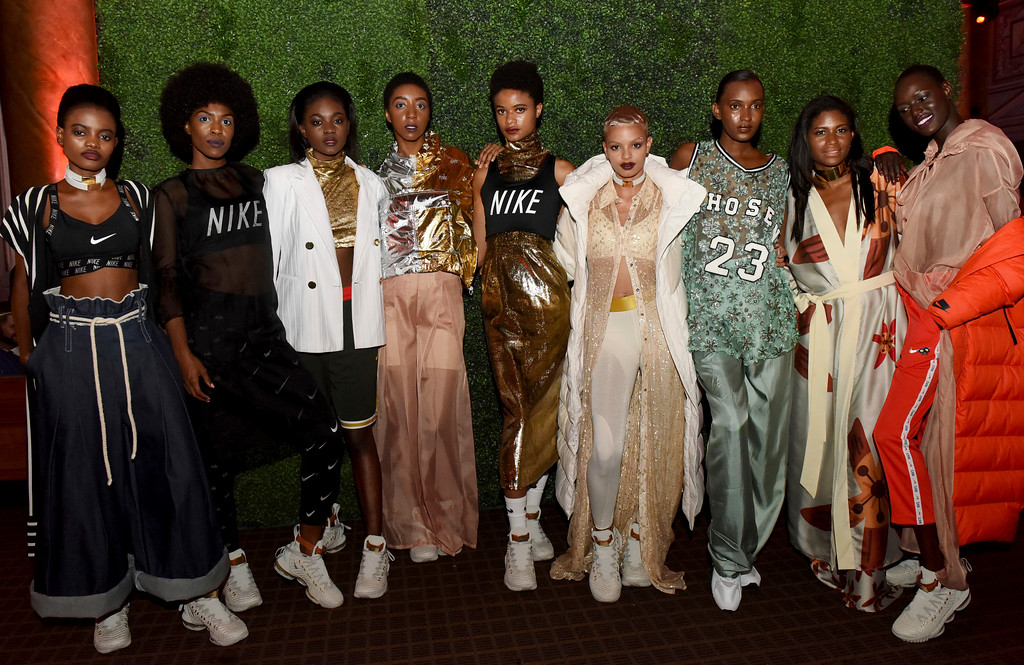 . Models display the HFR x LeBron 16 shoe at it\'s unveiling at the Harlem Fashion Row show and awards ceremony before the start of New York Fashion Week, Tuesday, Sept. 4, 2018. (AP Photo/Diane Bondareff)