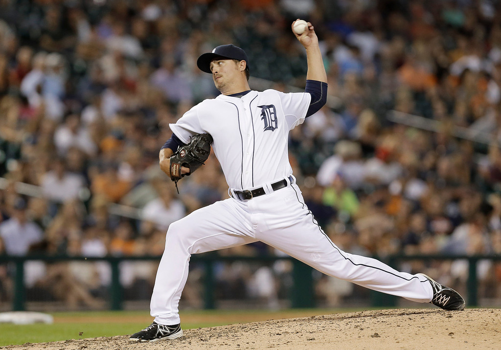 . Detroit Tigers pitcher Blaine Hardy throws against the Kansas City Royals  in the seventh inning of a baseball game in Detroit, Monday, June 16, 2014.  (AP Photo/Paul Sancya)